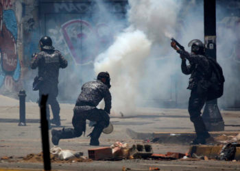 Security forces members fire tear gas canisters after clashes broke out while the Constituent Assembly election was being carried out in Caracas, Venezuela, July 30, 2017. REUTERS/Carlos Garcia Rawlins