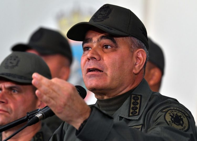 Venezuelan Defense Minister Vladimir Padrino gestures as he delivers a speech in Caracas on February 19, 2019. (Photo by Yuri CORTEZ / AFP)