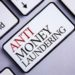 Word writing text Anti Monay Laundring. Business concept for entering projects to get away dirty money and clean it written White Keyboard Key with copy space. Top view.