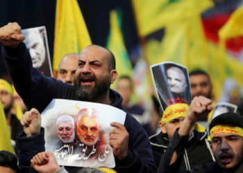 FILE PHOTO: FILE PHOTO: Lebanon's Hezbollah supporters chant slogans during a funeral ceremony rally to mourn Qassem Soleimani, head of the elite Quds Force, who was killed in an air strike at Baghdad airport, in Beirut's suburbs, Lebanon, January 5, 2020. REUTERS/Aziz Taher/File Photo/File Photo