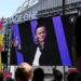 People wacth on a giant screen, set outside the venue at the Paris Expo of Portes de Versaille, the Chinese Alibaba group CEO Jack Ma speaking during the Vivatech startups and innovation fair, in Paris on May 16, 2019. (Photo by ALAIN JOCARD / AFP)        (Photo credit should read ALAIN JOCARD/AFP via Getty Images)