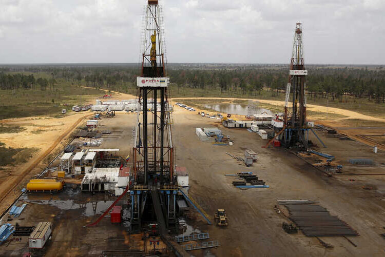FILE PHOTO: Drilling rigs are seen at an oil well operated by Venezuela's state oil company PDVSA, at the oil rich Orinoco belt, near Morichal  at the state of Monagas April 16, 2015.  REUTERS/Carlos Garcia Rawlins/File Photo