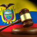Law and justice of Ecuador concept with a 3d rendering of a gavel on a wooden desktop and the Ecuadorian flag on background.