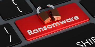 Ransomware red button on keyboard, 3D rendering