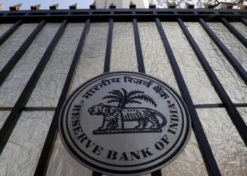 The Reserve Bank of India (RBI) seal is pictured on a gate outside the RBI headquarters in Mumbai, India, February 2, 2016. India's central bank kept its policy rate on hold at 6.75 percent on Tuesday, as widely expected, opting to wait until after the government's annual budget statement at the end February to decide on whether to cut interest rates further. REUTERS/Danish Siddiqui