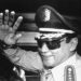 FILE - In this Aug. 31, 1989 file photo, Gen. Manuel Antonio Noriega waves to newsmen after a state council meeting, at the presidential palace in Panama City, where they announced the new president of the republic. Panama's ex-dictator Noriega died Monday, May 29, 2017, in a hospital in Panama City. He was 83. (AP Photo/Matias Recart, File)